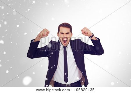 Furious businessman tensing arms muscle against snow