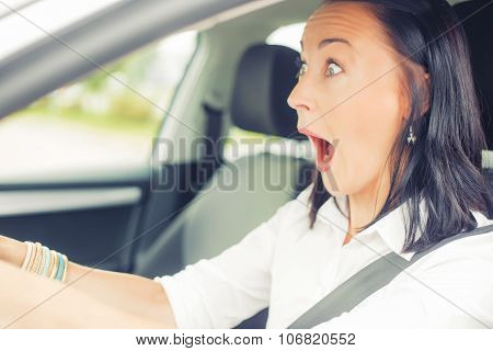 Surprised woman in the car
