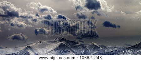 Panoramic View On Evening Mountains And Cloudy Sky