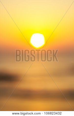Vertical blured orange sunset background.