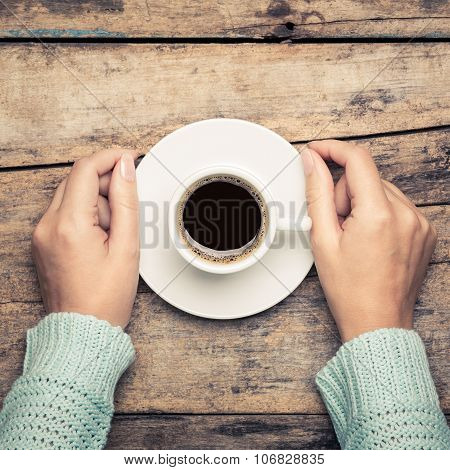 Woman Holding Cup Of Espresso On Wooden Table.