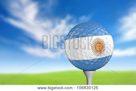 Golf ball with Argentina flag colors sitting on a tee