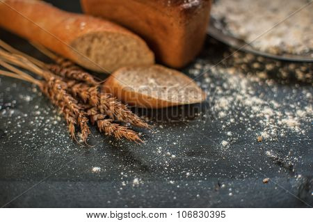 Bread composition with wheats. Very shallow DOF photo and specific art curly bokeh for extra volume.