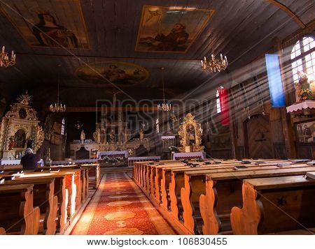 Koszecin, Poland 01 November 2015 .: Rays Of The Sun Illuminate The Old, Dark Wooden Church Of The H