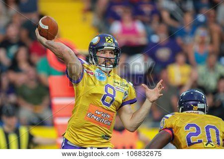 ST. POELTEN, AUSTRIA - JULY 26, 2014: QB Christoph Gross (#8 Vikings) passes the ball during Austrian Bowl XXX.