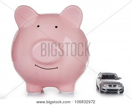 Pig moneybox and toy car isolated on white