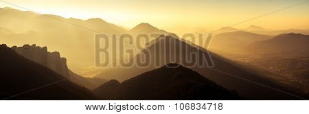 Panoramic Scenic View Of Mountains And Hills Silhouette At Sunset