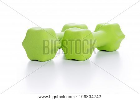 Fitness Concept With Two Green Dumbbells On White Background