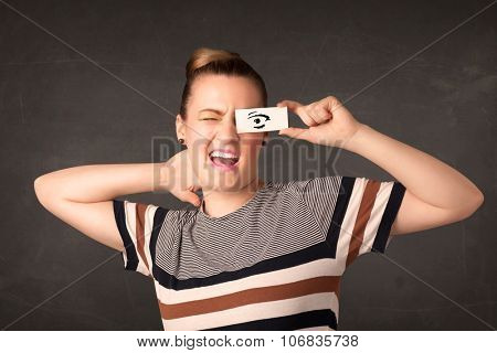 Silly youngster looking with hand drawn eye paper concept