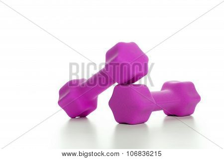 Fitness Concept With Two Pink Dumbbells On White Background