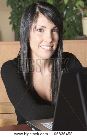 beautiful confident young female student studying.