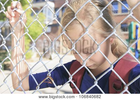 Sad fence girl