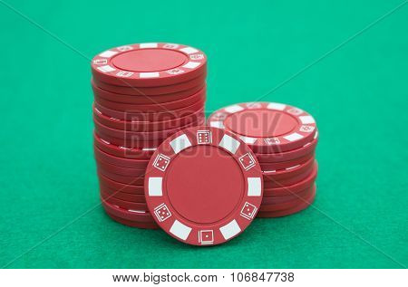 Lots Of Red Poker Chips On Casino Table