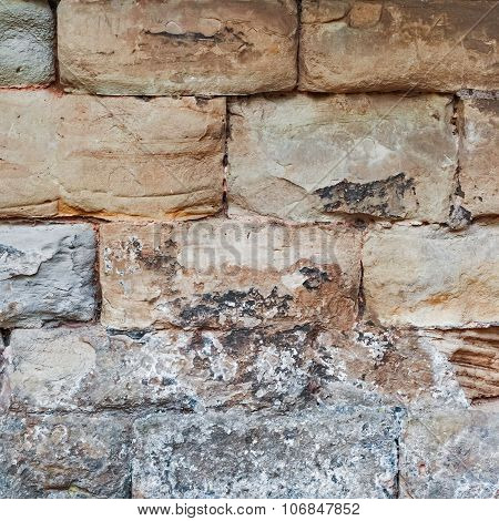Limestone medieval wall of stone blocks texture background surface empty square closeup