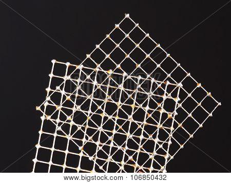 Two tin wire grids with practice solder joints on every intersection