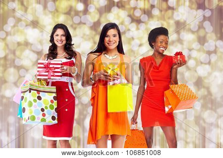 Group of Woman with shopping bags over Christmas background.