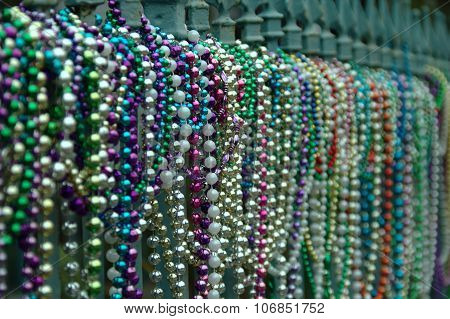 Beads aligned on fence in New Orleans in Louisiana after Mardi Gras
