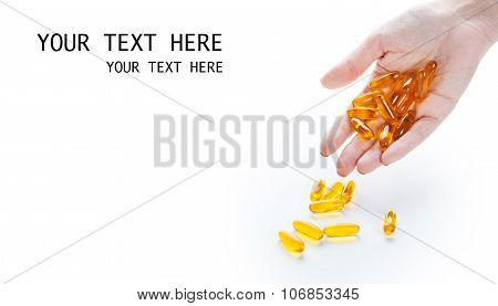 Soft Gels Pills With Omega-3 Oil In Hand Closeup On White