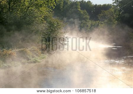 Foggy Morning With Steam Rising Off River