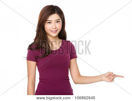 Young woman with finger point aside