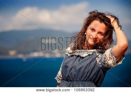 Brunette Girl In Short Jeans Dress Looks At Camera