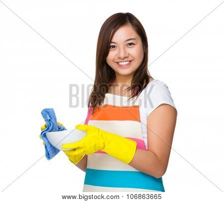 Young Housewife wash the dish