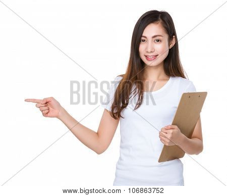 Woman hold with clipboard and finger point aside