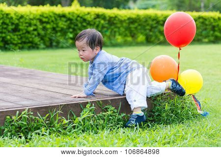Little bot crawling a step at park