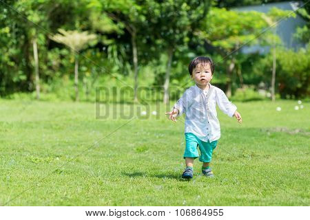 Little boy playing at oudoor