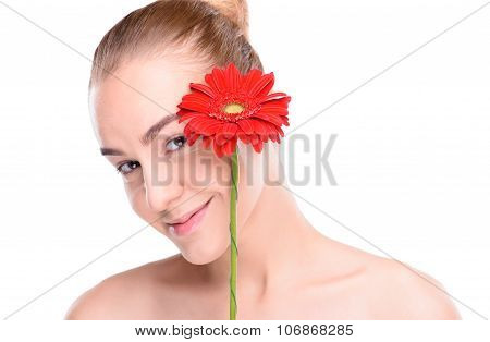 Cheerful beautiful woman with red gerbera. Isolated on white background