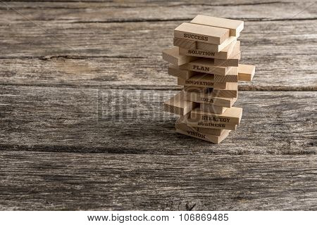 Wooden Pegs Build In A Tower Like Structure Wth Some Of Them Reading Words That Represent The Most I
