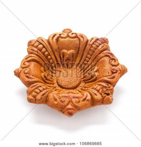 Beautifully carved designer clay lamp.