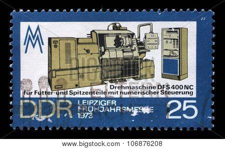 GDR - CIRCA 1973: a stamp printed in GDR shows Lathe Machine, Leipzig Spring Fair, circa 1973