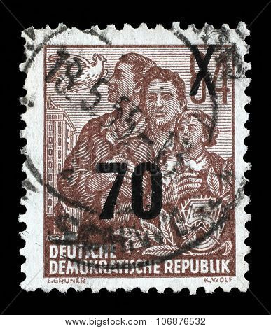 GDR - CIRCA 1955: A stamp printed in GDR, shows a family, series Five-year plan, circa 1955