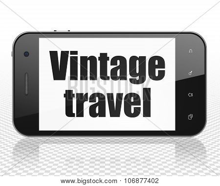 Travel concept: Smartphone with Vintage Travel on display