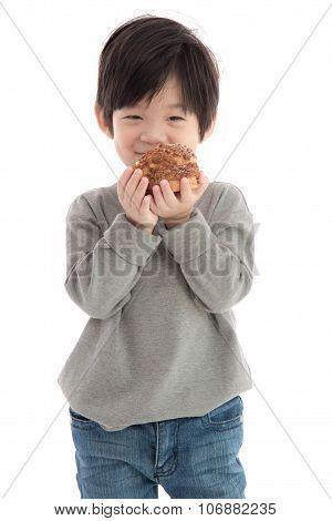 Cute Asian Boy Eating Cream Puff