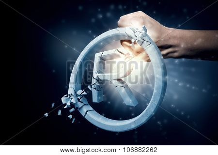 Close up of human hand breaking stone copywriting sign