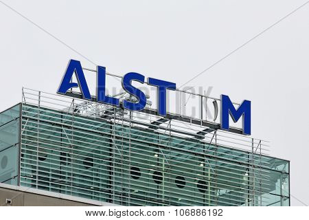 BADEN, SWITZERLAND. November 2nd 2015. Alstom logo on rooftop of thermal power headquarters being removed for merger and acquisition of General Electric.
