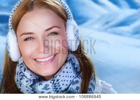 Closeup portrait of beautiful smiling woman outdoors, wearing warm knitted set, winter fashion, happy wintertime holidays