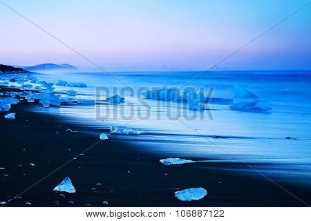 Iceberg on the black sand beach, melting glacier on the shore of North Atlantic Ocean, stunning scandinavia, landscape of North Pole, Vatnajokull National Park, Jokulsarlon landmark, Iceland