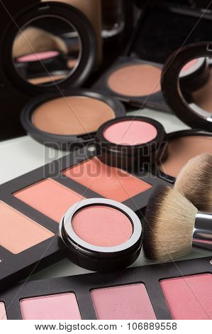 make-up cosmetics. compact powder, mineral foundation and makeup brushes