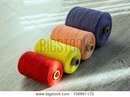 Colored Spools Of Thread For Sewing, Side View