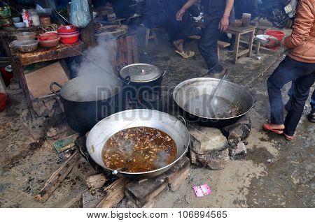 Meat Boiling In A Caldron In Bac Ha Market, Vietnam