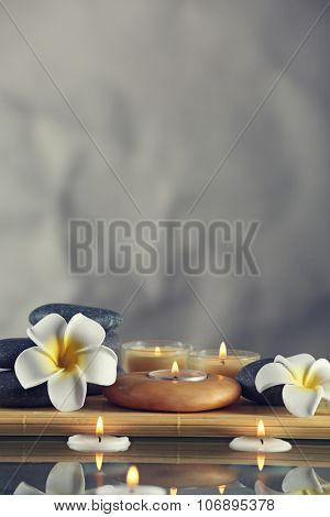 Still life with spa stones on grey background
