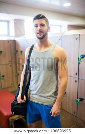 Man getting ready to hit the gym in the gym locker room