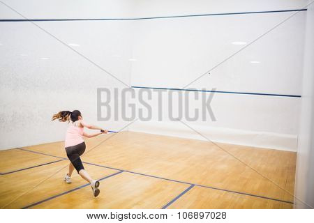 Woman playing a game of squash in the squash court