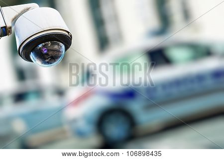 Security Camera And Urban Video With Blur Police Car On Background