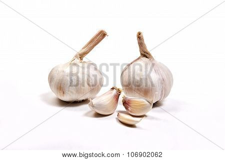 Two Garlic Heads Isolated On White Background