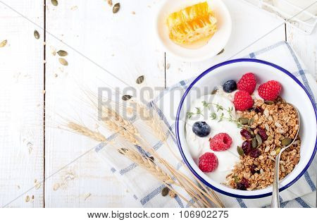Healthy breakfast. Granola with pumpkin seeds, honey, yogurt ,fresh berries.