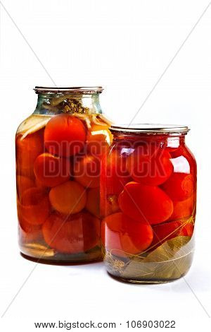 Two Glass Jars Of Canned Tomatoes On White Background.